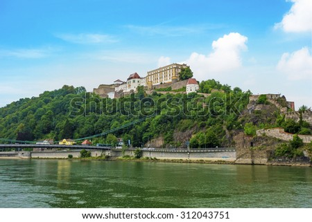 Veste Oberhaus, historical stronghold of the old historical city of Passau, a famous tourist spot - view from town hall near the river Donau - stock photo
