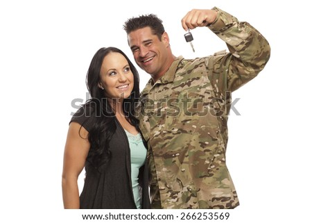 VETERAN SOLDIER and his military spouse buying a new car.  Sergeant and his wife or girlfriend with new car key on white background.  Military Lending | Payday Loan - stock photo