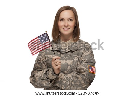 Veteran soldier Female holding an American Flag - stock photo
