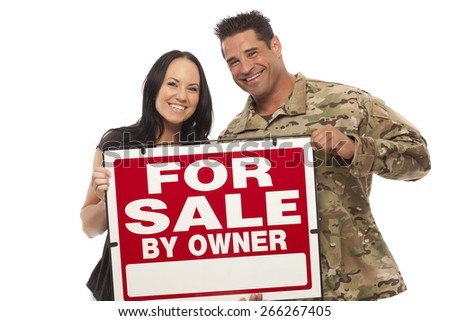 Veteran Soldier   Happy young couple with for sale by owner sign - stock photo