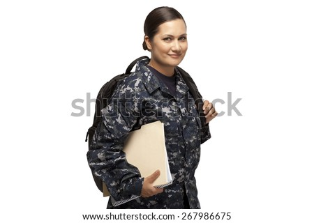 VETERAN SOLDIER | MILITARY COLLEGE BENEFITS | CASH FOR SCHOOL | Portrait of smiling female navy sailor with shoulder bag and books, using GI Bill money to go back to school.  - stock photo