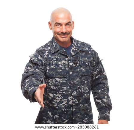 Veteran Soldier   Navy sailor or chief with hand extended for hand shake on white background and smiling. - stock photo