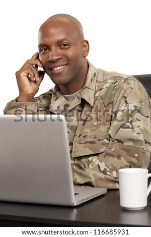 VETERAN SOLDIER | Smiling African American serviceman on the phone - stock photo