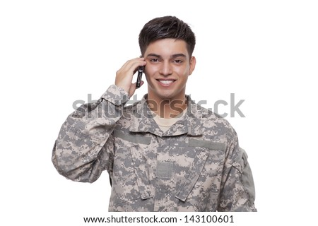 VETERAN SOLDIER | Smiling army sergeant talking on the phone  - stock photo