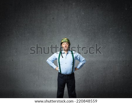 veteran soldier with helmet on head - stock photo