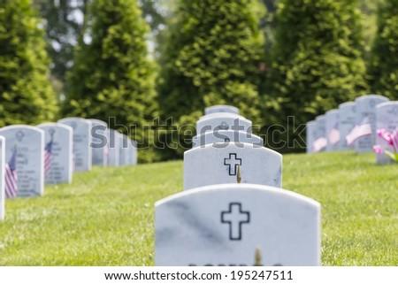 veterans cemetery memorial celebration with American Flag - stock photo