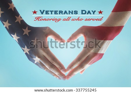 Veterans day holiday celebration concept: American flag pattern on human hands in heart sign shape with text message honor all who served for brave military veterans on vintage  blue sky background - stock photo