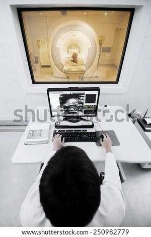 veterinarian doctor with MRI computer control,selective color technique - stock photo
