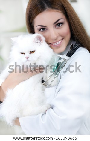 veterinarian hugging a white Persian Cat