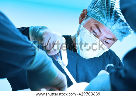 veterinarian surgery in operation room take with art lighting and blue filter - stock photo