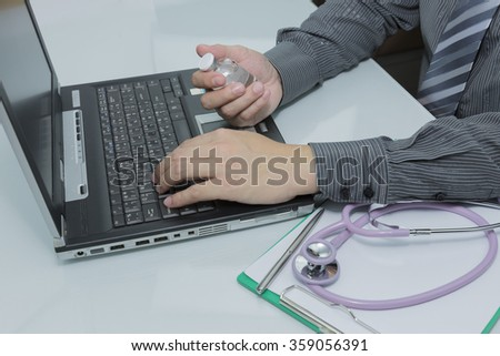 Veterinarian typing on keyboard the prescriptions in medical office