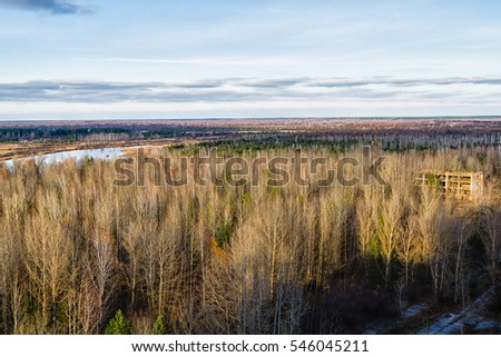 Vew from roof of 16-storied apartment house in Pripyat town, Chernobyl Nuclear Power Plant Zone of Alienation, Ukraine. Rivers, lakes, forest and Belarus in the background. Polesia region.