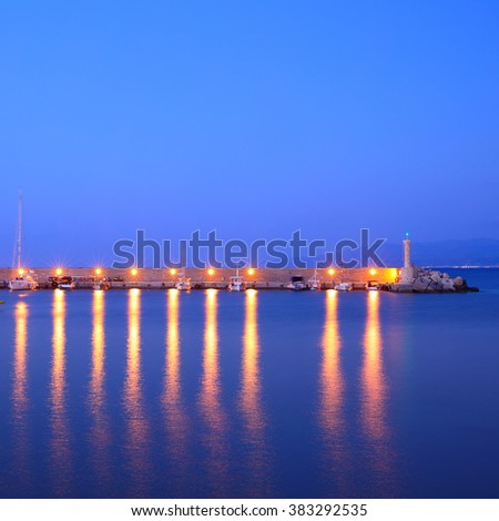 Vew of port with reflection in water - stock photo