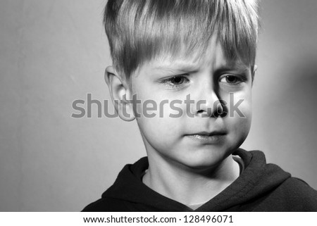 vexed little boy, black and white - stock photo