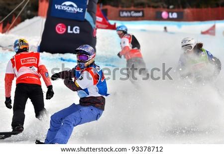 VEYSONNAZ, SWITZERLAND - JANUARY 22: World Champion Lindsay Jacobellis (USA)  (3) at the finish of the FIS World Championship Snowboard Cross finals : January 22, 2012 in Veysonnaz Switzerland - stock photo