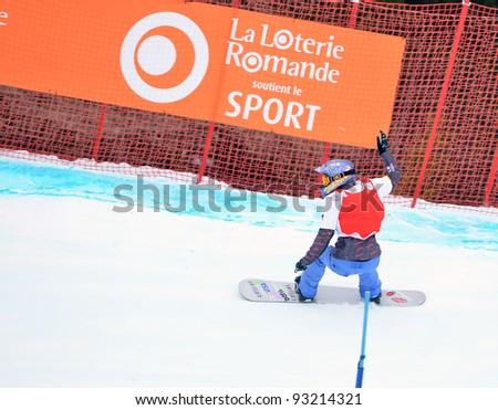 VEYSONNAZ, SWITZERLAND - JANUARY 19: World Champion Lindsay Jacobellis (USA) in the FIS World Championship Snowboard Cross finals : January 19, 2012 in Veysonnaz Switzerland - stock photo