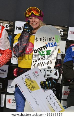 VEYSONNAZ, SWITZERLAND - JANUARY 22: World champion Lindsay Jacobellis (USA) with her check at the FIS World Championship Snowboard Cross finals on January 22, 2012 in Veysonnaz, Switzerland