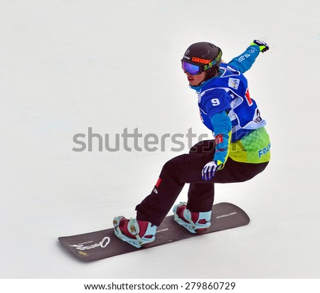 VEYSONNAZ, SWITZERLAND - MARCH 14: Chloe TRESPEUCH (FRA) competing in the finals of the Snowboard Cross World Cup: March 14, 2015 in Veysonnaz, Switzerland - stock photo