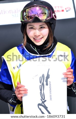 VEYSONNAZ, SWITZERLAND - MARCH 11: Finalist Yuka FUJIMORI (JPN) on the podium in the Snowboard Cross World Cup: March 11, 2014 in Veysonnaz, Switzerland