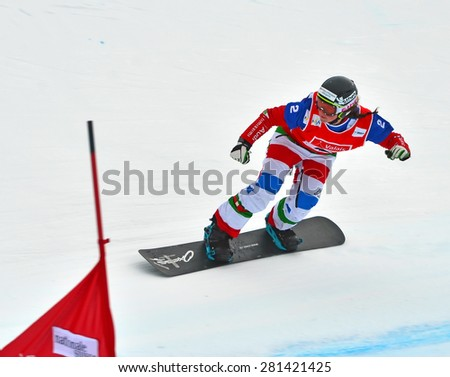 VEYSONNAZ, SWITZERLAND - MARCH 14:  Michaela MOIOLI (ITA) competing in the finals of the Snowboard Cross World Cup: March 14, 2015 in Veysonnaz, Switzerland - stock photo