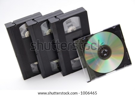 VHS cassettes and CD disc on white background - stock photo
