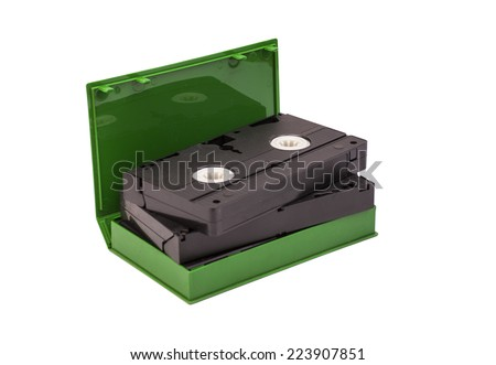 VHS video tape cassettes in case on white background  - stock photo