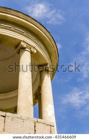 Via Santo Stefano and Portico Columns, Bologna, Italy - stock photo