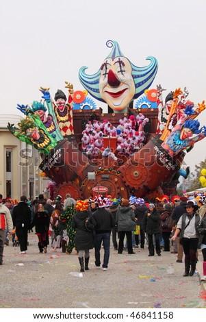 VIAREGGIO - FEBRUARY 14: Carnival floats parade on the promenade of Viareggio, filled with people during the famous Carnival of Viareggio February 14, 2010 in Viareggio, Italy - stock photo