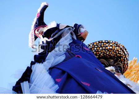 VIAREGGIO, ITALY - FEB 10: Dancer on a carnival float on the streets of Viareggio at the Carnival of Viareggio February 10, 2013 in Viareggio, Italy. - stock photo