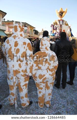 VIAREGGIO, ITALY - FEB 10: Masked participants on the street at carnival  of Viareggio, Viareggio carnival , February 10, 2013 in Viareggio, Italy. - stock photo