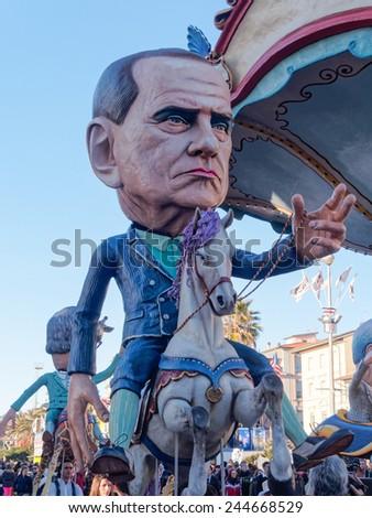 VIAREGGIO, ITALY - FEBRUARY 2:   allegorical mask of ex Italian prime minister Silvio Berlusconi at Viareggio Carnival held February 2, 2013 - stock photo