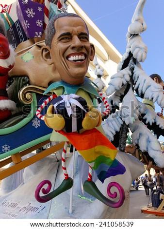 VIAREGGIO, ITALY - FEBRUARY 23:   allegorical mask of president Obama at Viareggio Carnival held February 23, 2014 - stock photo