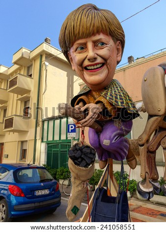 VIAREGGIO, ITALY - FEBRUARY 23:   allegorical mask of prime minister Angela Merkel at Viareggio Carnival held February 23, 2014 - stock photo