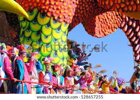 VIAREGGIO, ITALY - 10 FEBRUARY 2013. Festival.Colorful carnival float with happy, masked dancers during Carnival of Viareggio on february 10, 2013 in Viareggio, Italy - stock photo