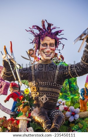 VIAREGGIO, ITALY - FEBRUARY 21: Festival, the parade of carnival floats with dancing people on streets of Viareggio. February 21, 2010, taken in Viareggio, Italy - stock photo