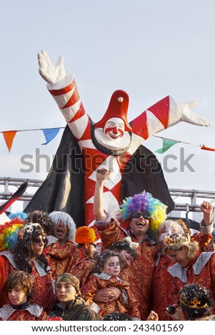 VIAREGGIO, ITALY - FEBRUARY 10: Festival, the parade of carnival floats with dancing people on streets of Viareggio. February 10, 2013, taken in Viareggio, Italy - stock photo