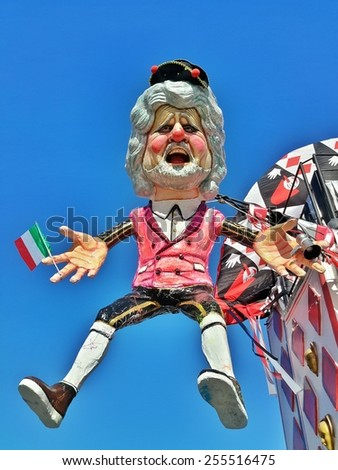 VIAREGGIO, ITALY - FEBRUARY 22: Festival, the parade of carnival floats with dancing people on streets of Viareggio. February 22, 2015, taken in Viareggio, Italy - stock photo