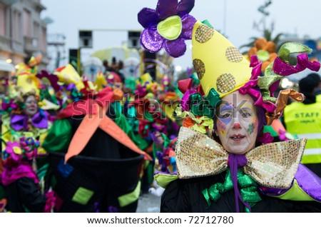 VIAREGGIO, ITALY - FEBRUARY 27: Man smiles in carnival mask, during the famous Carnival of Viareggio February 27, 2011 in Viareggio, Italy - stock photo