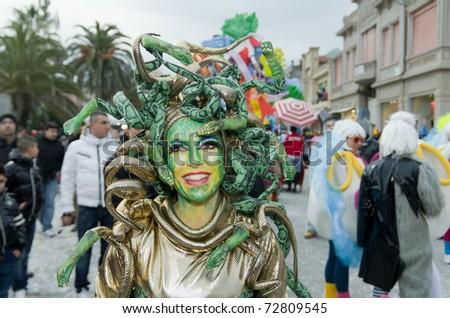 VIAREGGIO, ITALY - FEBRUARY 27: Unidentified beautiful woman smiles in carnival costume during the famous Carnival of Viareggio on February 27, 2011 in Viareggio, Italy - stock photo
