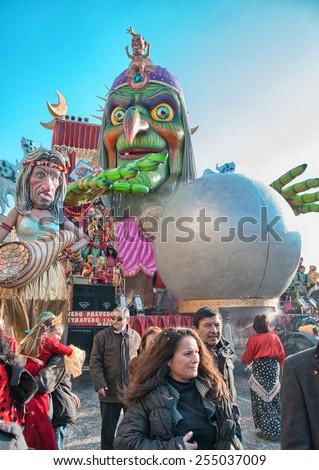 VIAREGGIO, ITALY - MAR 4: Carnival float with parades on the promenade of Viareggio, during Carnival on March 4, 2010 in Viareggio, Italy. - stock photo