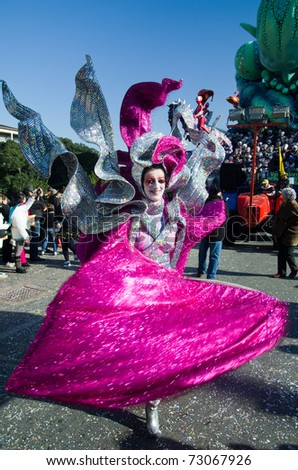 VIAREGGIO, ITALY - MARCH 8:  beautiful woman smiling in carnival mask, during the famous Carnival of Viareggio on march 8, 2011 in Viareggio, Italy - stock photo