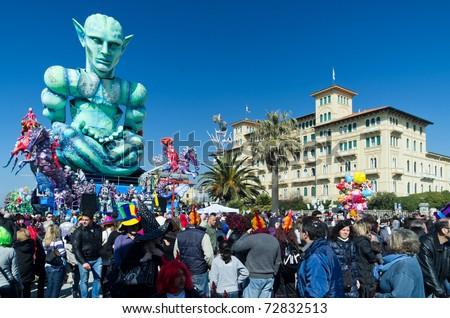 VIAREGGIO, ITALY - MARCH 6:  Carnival float with a giant robot parades on the promenade of Viareggio, during Carnival on March 6, 2011 in Viareggio, Italy - stock photo