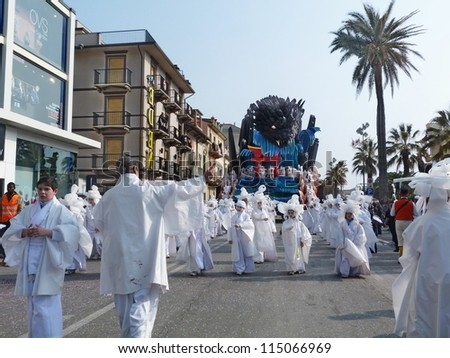 VIAREGGIO, ITALY - MARCH 4:Group masked at the parades on the promenade during the famous annual Italian Carnival of Viareggio on march 4, 2012  in Viareggio, Italy - stock photo