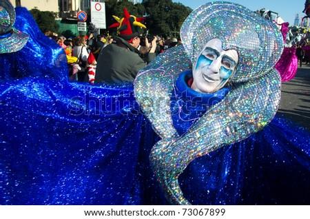 VIAREGGIO, ITALY - MARCH 8:  old man smiling in carnival mask, during the famous Carnival of Viareggio on march 8, 2011 in Viareggio, Italy - stock photo