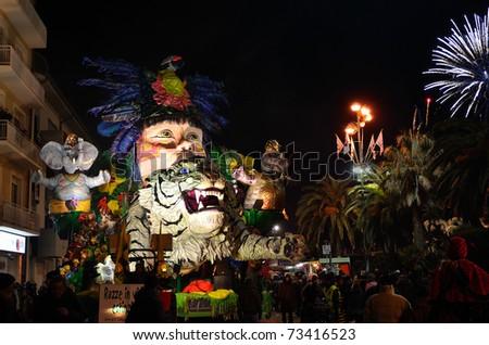 VIAREGGIO - MARCH 8: Night carnival floats parade on the promenade of Viareggio, during the famous Carnival of Viareggio on March 8, 2011 in Viareggio, Italy - stock photo
