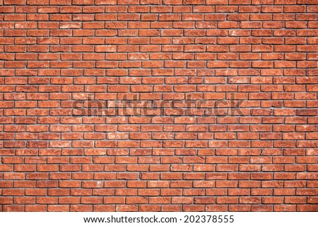 Vibrant and Colorful New Brick wall detailed background pattern photo with vignette - stock photo