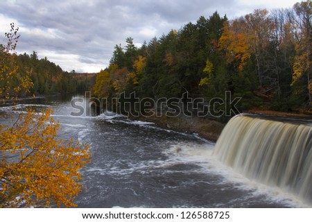 Vibrant autumn landscape with waterfall