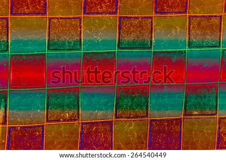 Vibrant background with rich Christmas colors of red, green, gold, and purple can be used in many ways including as beautiful wrapping paper. - stock photo