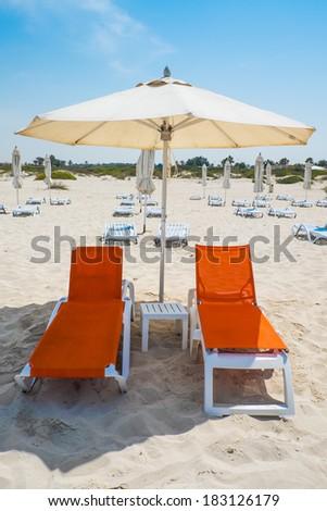 Vibrant beach chair - stock photo