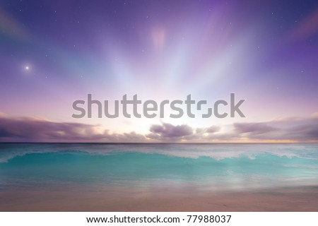 Vibrant beach sunrise sunset - stock photo